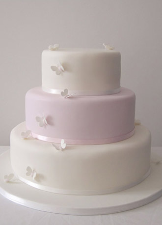 Simple clean lines on this beautiful wedding cake create a minimal look