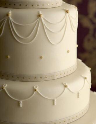 Ivory Swag Wedding Cake