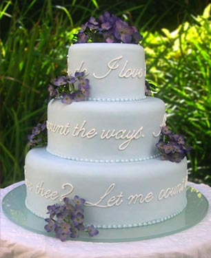 Picture of pale blue poetry wedding cake.
