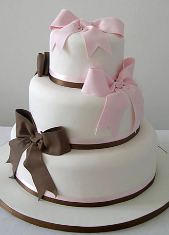 cake is decorated with beautiful handmade sugar ribbons