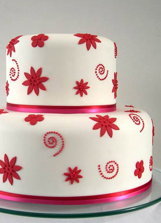 Red on white wedding cake